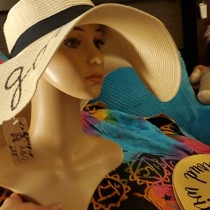 """Huge floppy beach hat with"""" life is good"""" on top"""